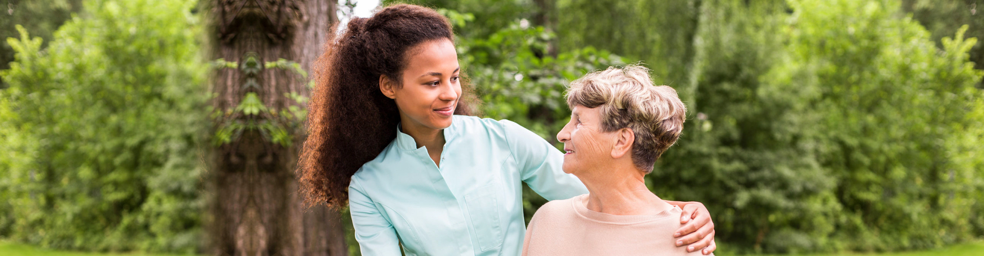 caregiver and senior woman smiling outdoor