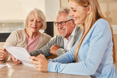 Daughter helps couple of seniors in retirement home with insurance and pension